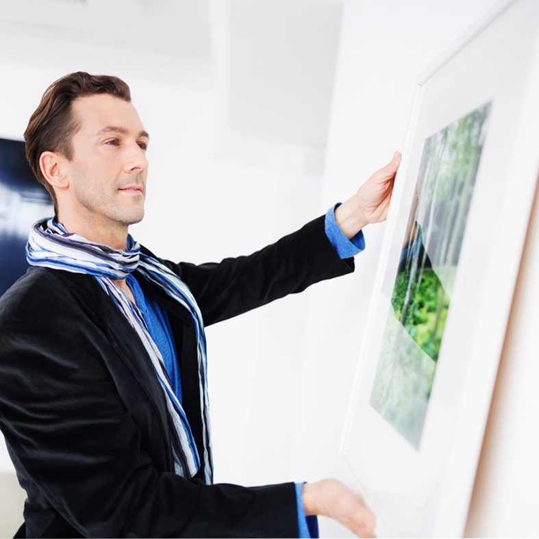 Gallery Owner Hanging Picture